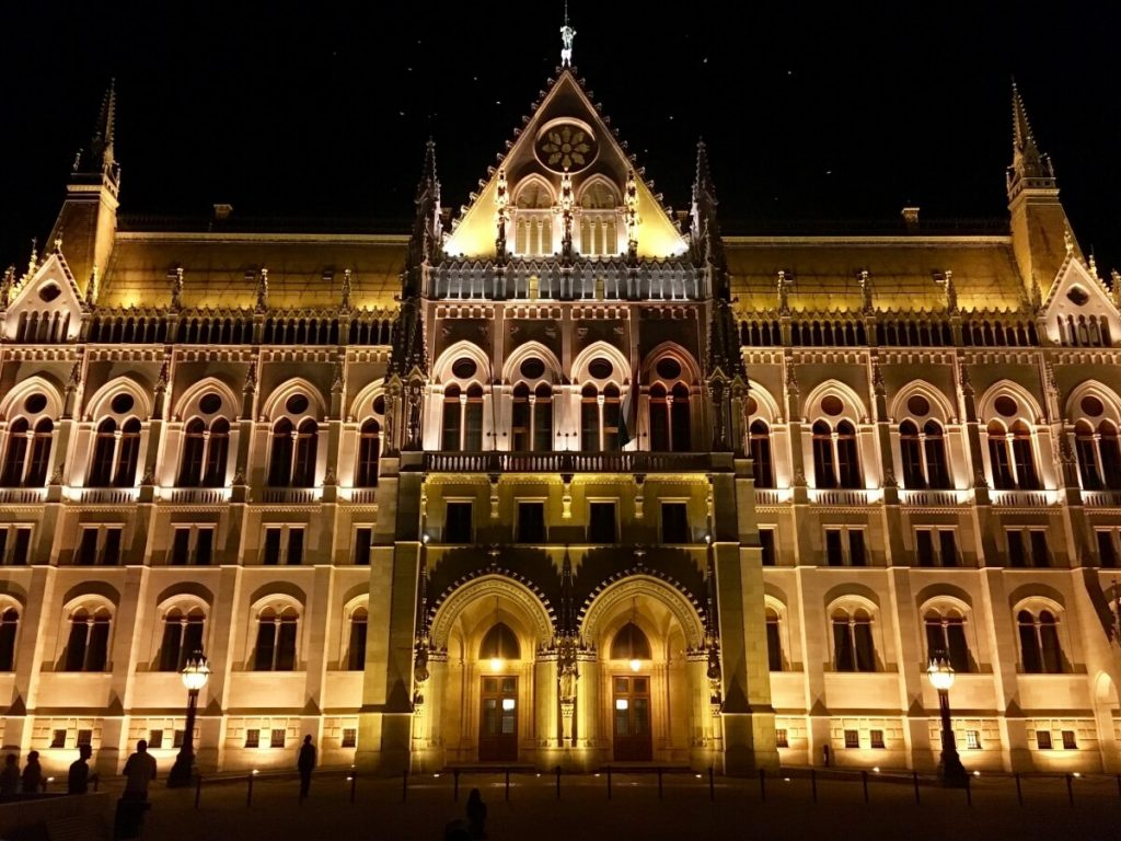 The Parliament Building all lit up at night in Budapest