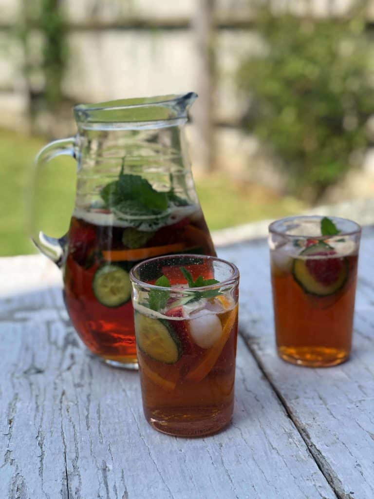 Pitcher of Pimm's in a garden | 12 Drinks From Around the World to Spark Your Wanderlust