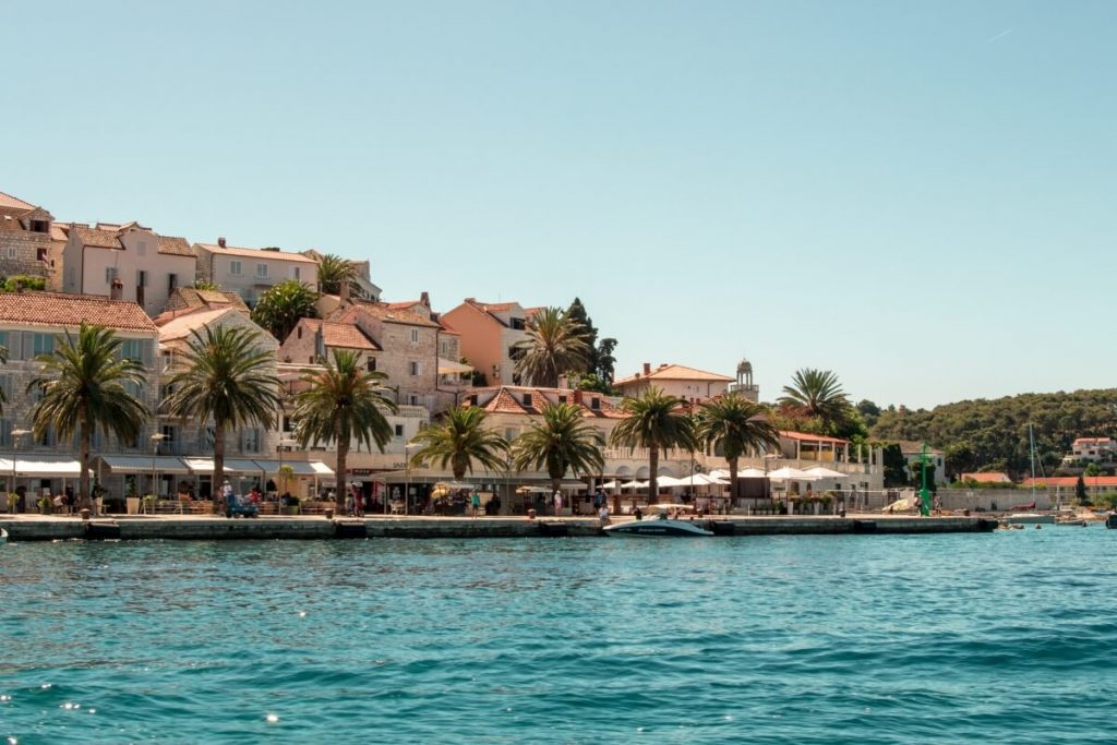 View of the Hvar Town waterfront promenade on a sunny day.