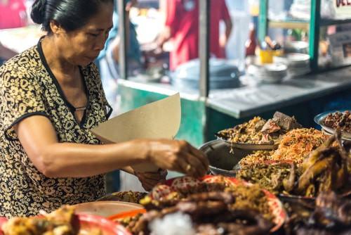 Indonesian woman preparing nasi ayam at Gianyar Night Market in Bali