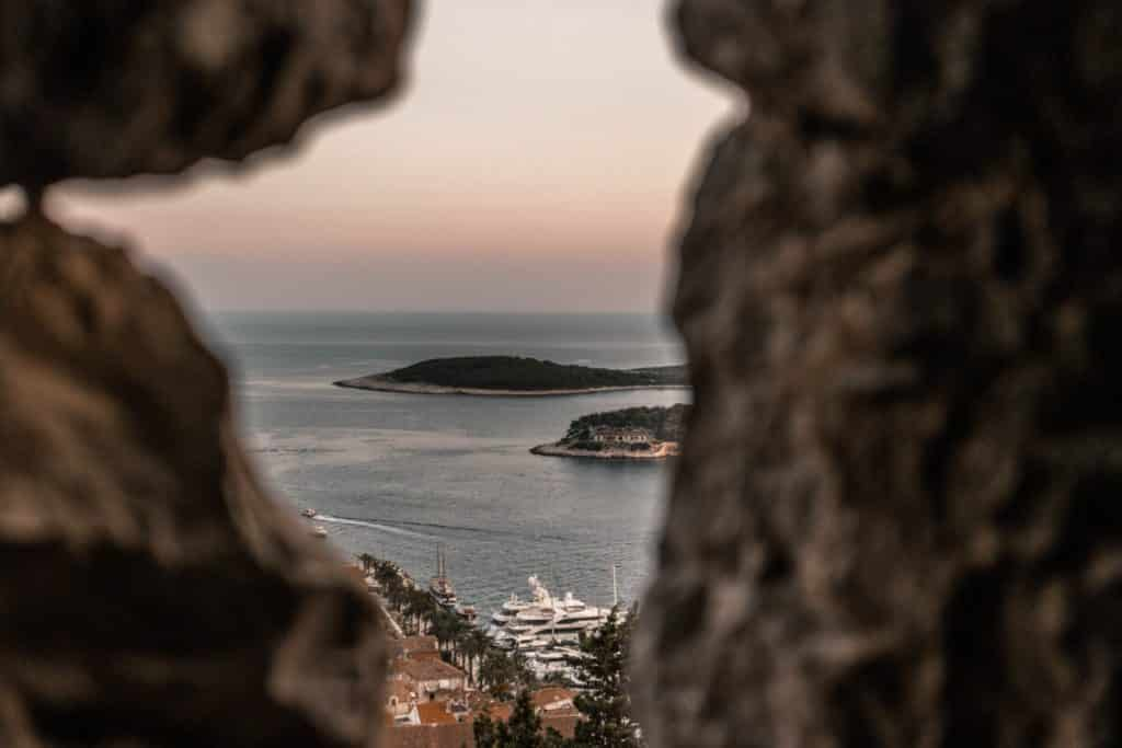 View through a stone window of the Pakleni Islands near Hvar Town, Croatia.