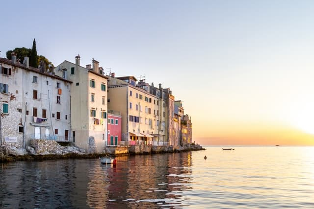 Pastel-colored houses packed together on the edge of Rovinj's peninsula in Croatia