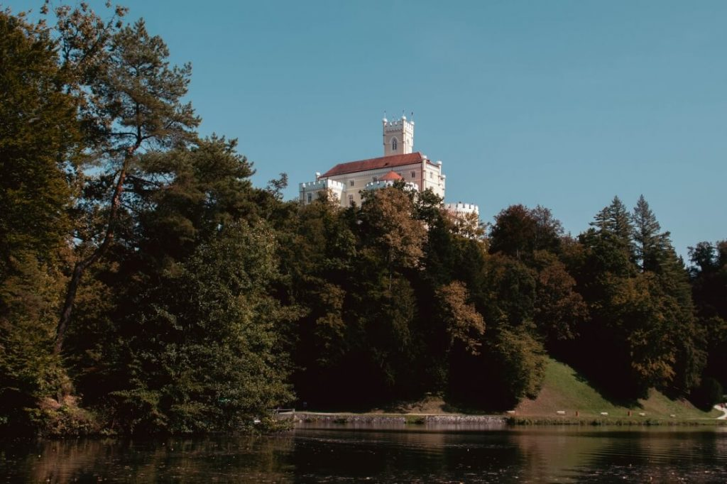 A view of the fairytale-like Trakoscan Castle from the surrounding lake.