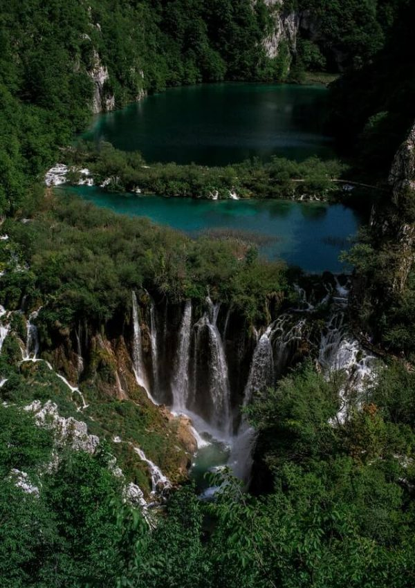 A beautiful blue lake and cascading waterfalls at Plitvice Lakes National Park in Croatia