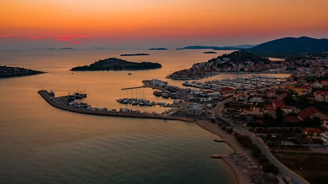 A gorgeous sunset over the small town of Tribunj in Croatia located on the Adriatic Sea.