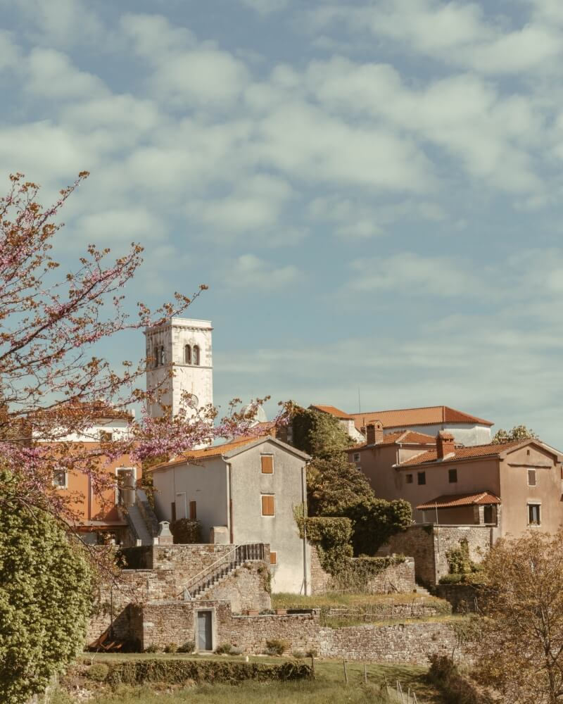 A beautiful blue sky over the small hilltop town of Oprtalj, located in the center of Istria, Croatia.