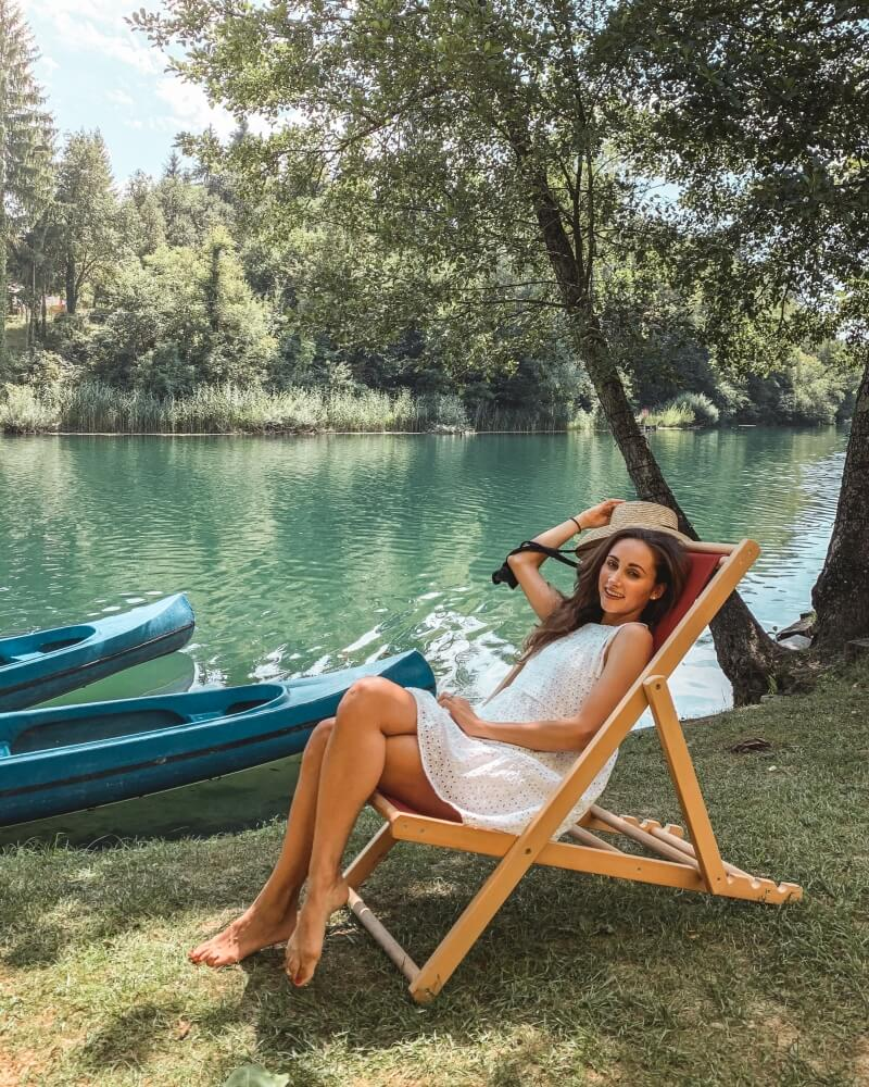 Girl sitting by the Mreznica River in Croatia on a day trip from Zagreb